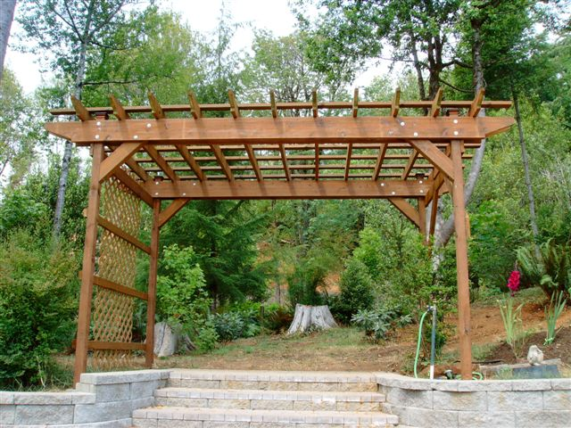 pergola-with-retainer-wall-by-www.homeimprovementingreenvillesc.com